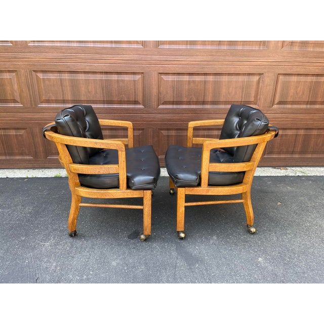Great pair of 70's Drexel exposed wood frame chairs with button tufted black vinyl cushions. You're buying these chairs...