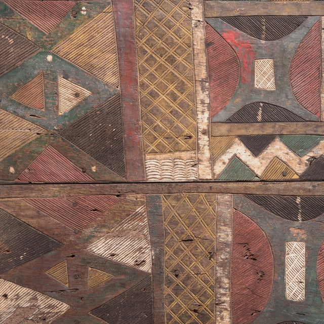 This colorful painted panel was created by an artisan of the Igbo people of Nigeria. Crafted from a dense hardwood known...