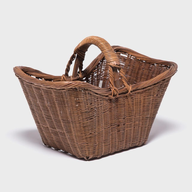 It's easy to imagine someone, long ago, walking to market on a beautiful summer day with this beautiful basket slung over...