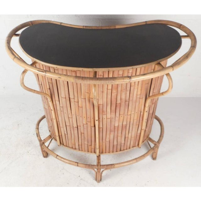 This beautiful vintage modern set comes with a tiki bar and two stools. The unique tiki bar is made of bamboo with a faux...