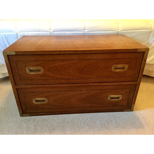 Campaign dresser by Drexel. This dresser/chest sits low with two large dovetailed drawers. Original brass hardware: two...