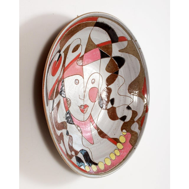 Stunning Vintage incised art pottery charger, depicting a playful harlequin jester! This is a fantastic piece of studio...