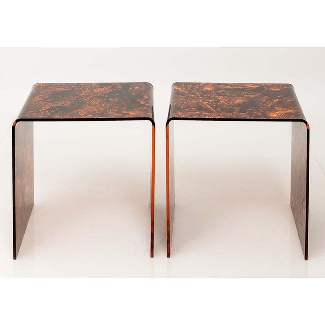 PLEASE INQUIRE ABOUT SHIPPING BEFORE PURCHASE Circa 1970 pair of acrylic side tables in a faux tortoise design and...
