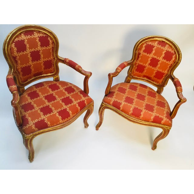 """Beautiful pair of late 19th century Lois XV armchairs. Original soft """"Venetian red"""" paint and 23k gold. Elegant lines,..."""