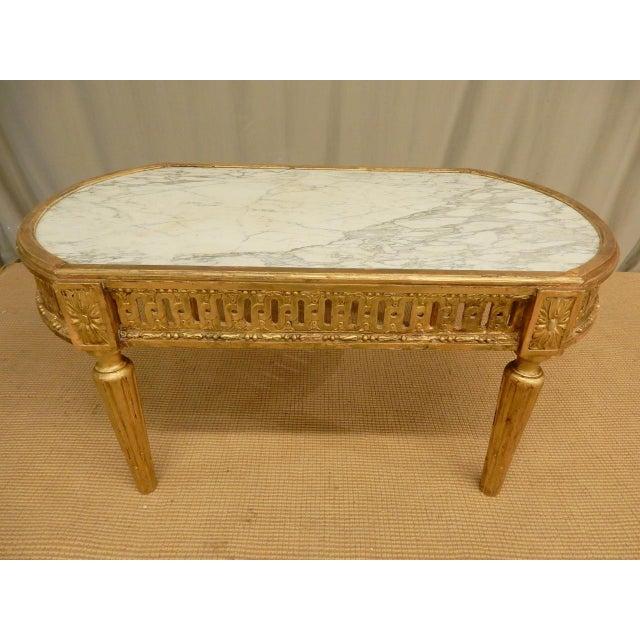 Very elegant Louis XVI table with original marble top.