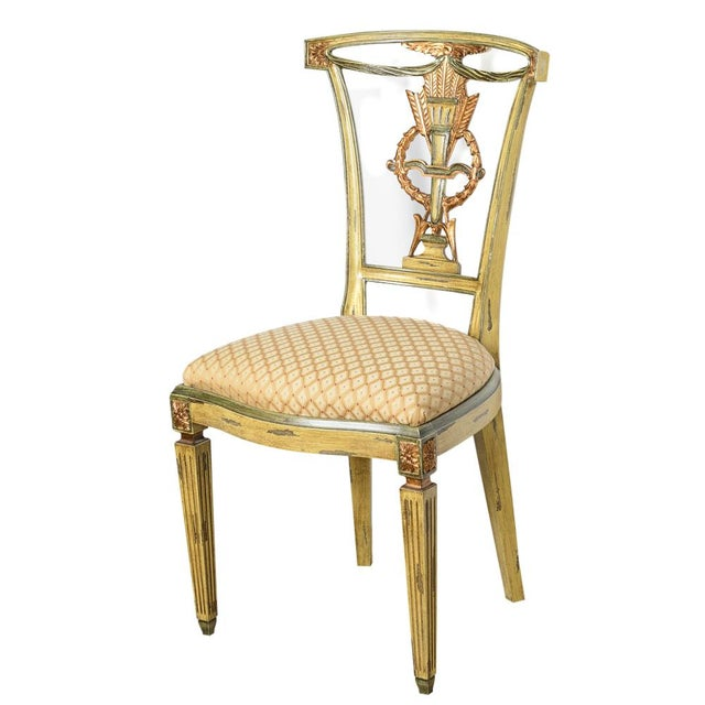 Charming set of 4 Italian Painted and Gilt chairs. Very clean upholstery. Very good condition. Brass plaque , Made in Italy.