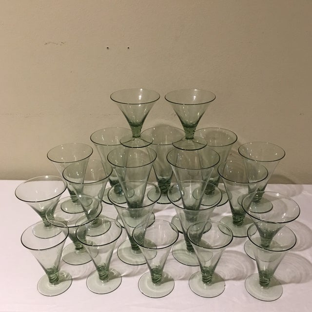 A beautiful set of 21 sleek green vintage glasses perfect for the holiday table. The set includes 5 water goblets, 6...