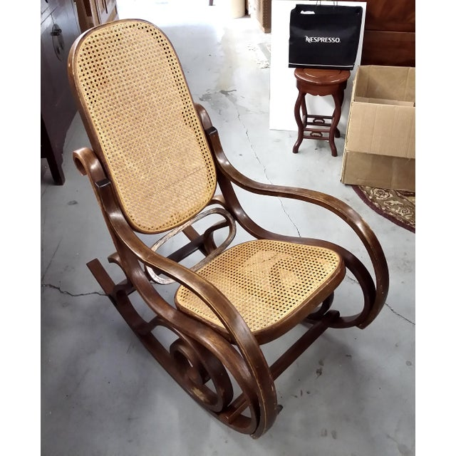 A wonderful rocker with the cane in mint condition. The wood on the rocker has some niks but they give a great rustic...