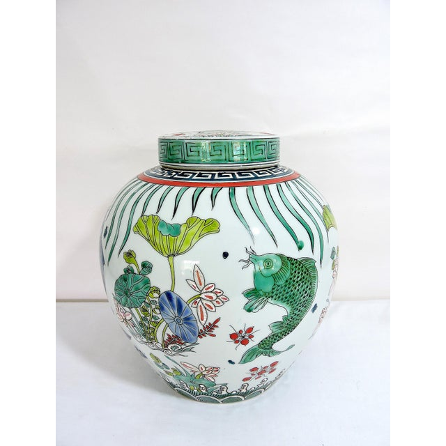 Chinese fish and lotus leaf ginger jar with Kangxi double blue ring as well as the six character hand written mark. Ovoid...