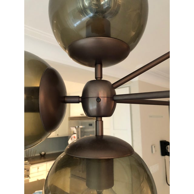 This is a vintage Modo chandelier. The piece is 3 Sided and features 10 globes. The piece was designed by Jason Miller for...