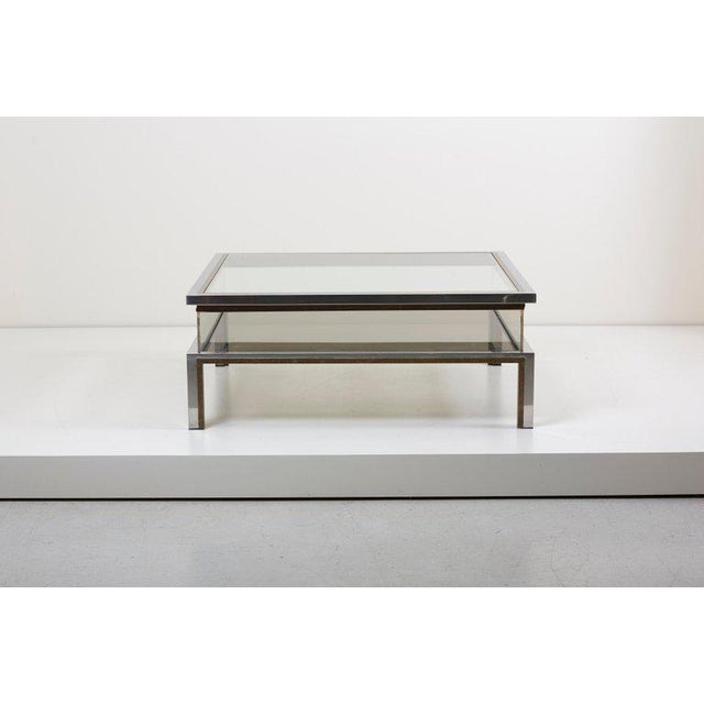 Large square glass table with sliding top by Maison Jansen. Frame has an total original gold-plated and chrome metal finish.