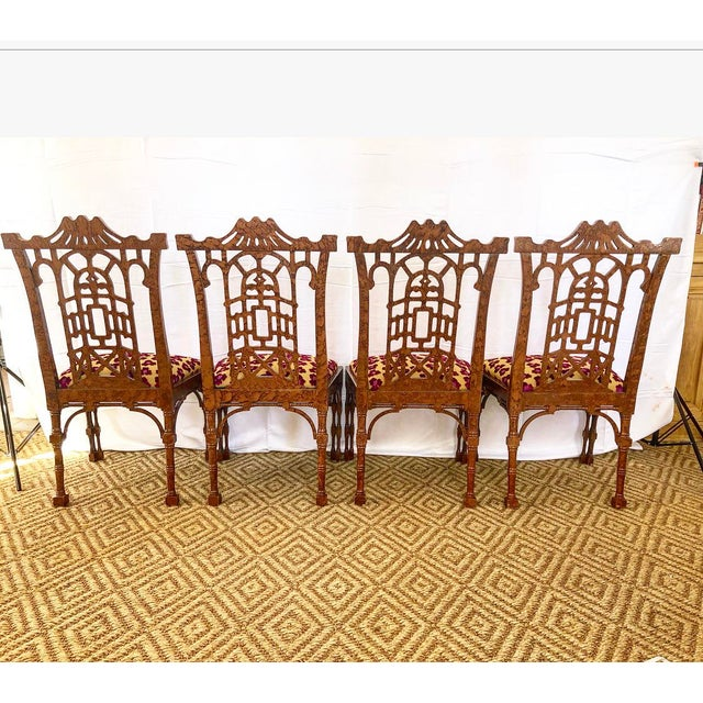 This set of 4 rare pagoda style dining chairs have a fretwork design back with an arched trellis design. All are in their...