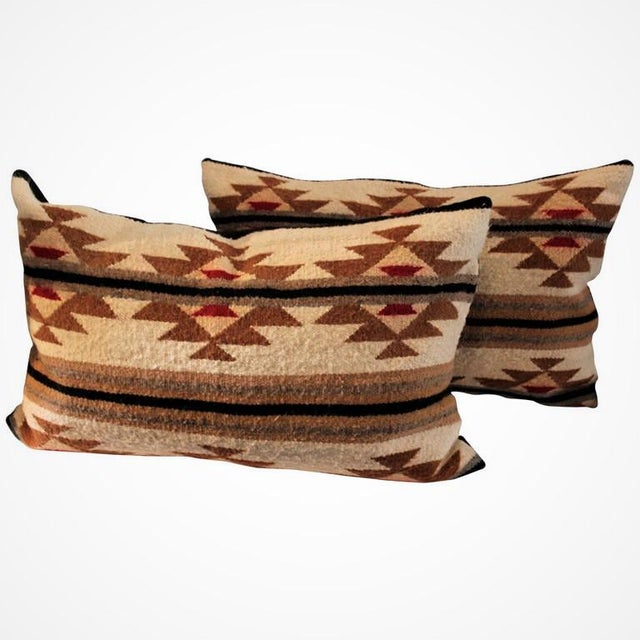 This is a great pair of geometric Navajo weaving pillows in a flying geese pattern. The condition is very good with cotton...