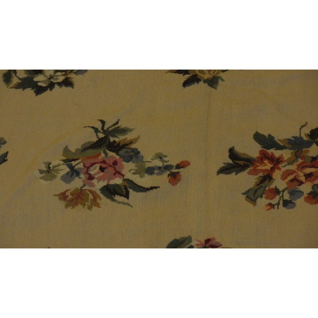 Wool, hand woven needle point rug in excellent condition.