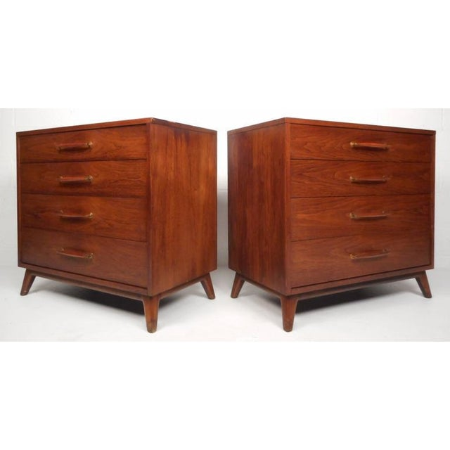 Well-designed pair of vintage modern dressers by Henredon feature four dovetailed drawers, wood handles with brass...