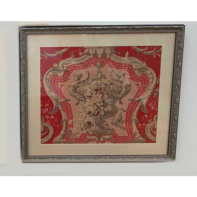 A lovely newly framed French vintage fabric that has the most beautiful salmon and cream design with an urn and flowers....