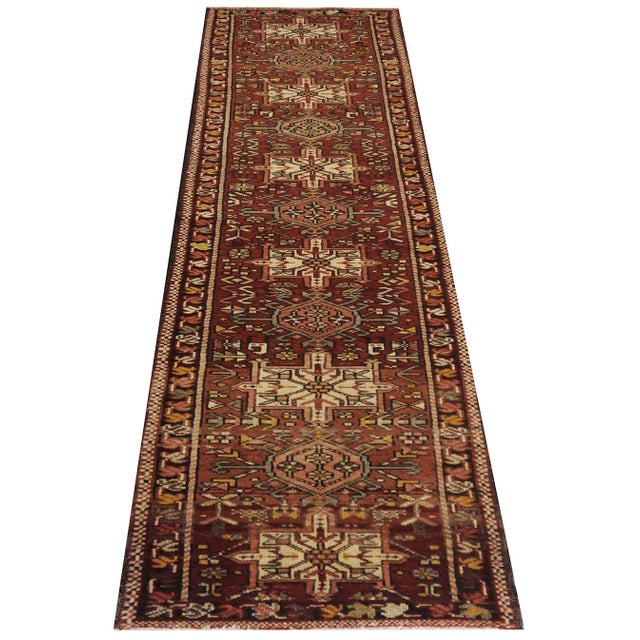This beautiful Rug is handmade, 100% wool pile, made in Iran. It features a geometric pattern in a vibrant combination of...