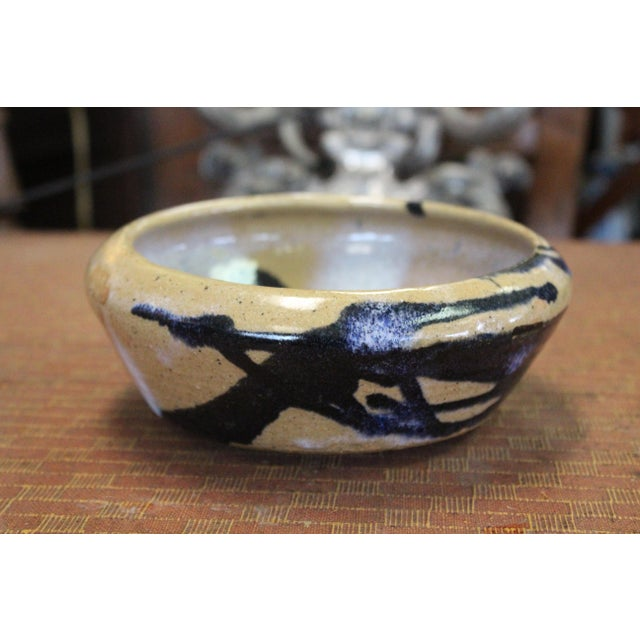 Tan and blue abstract Southwestern pottery bowl.