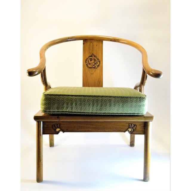 Vintage Chinese export carved elm wood horseshoe chair featuring a horseshoe shaped back and intricate carved Back-Splat....
