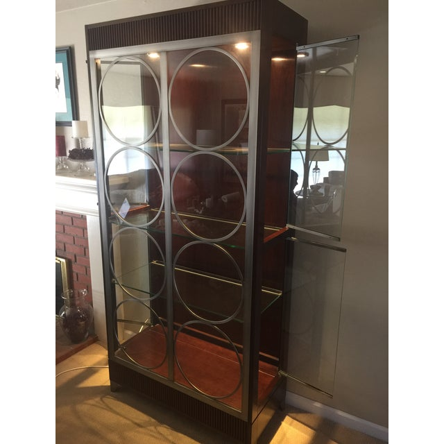 Beautiful late 20th Century modern style Art Deco Ethan Allen display cabinet. Cherry wood with pewter accent cabinet that...