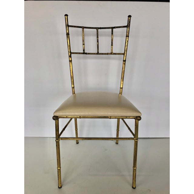 Mid Century Italian gold leaf chair with leather upholstery. We have two chairs available