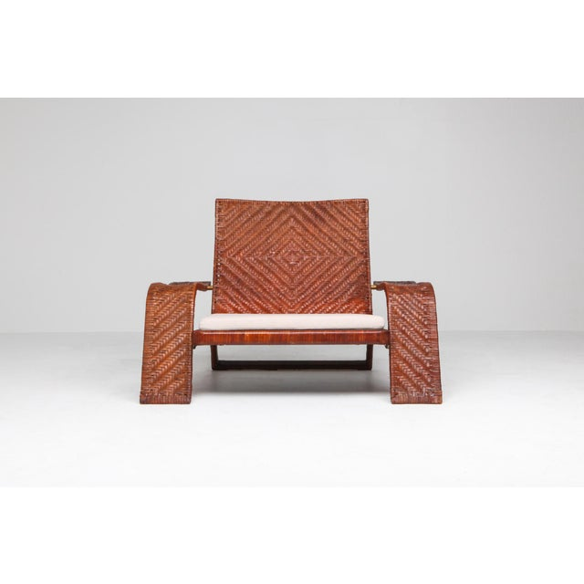 Postmodern lounge chair by Marzio Cecchi for Studio Most. Woven leather frame in diamond patterns finished with brass...