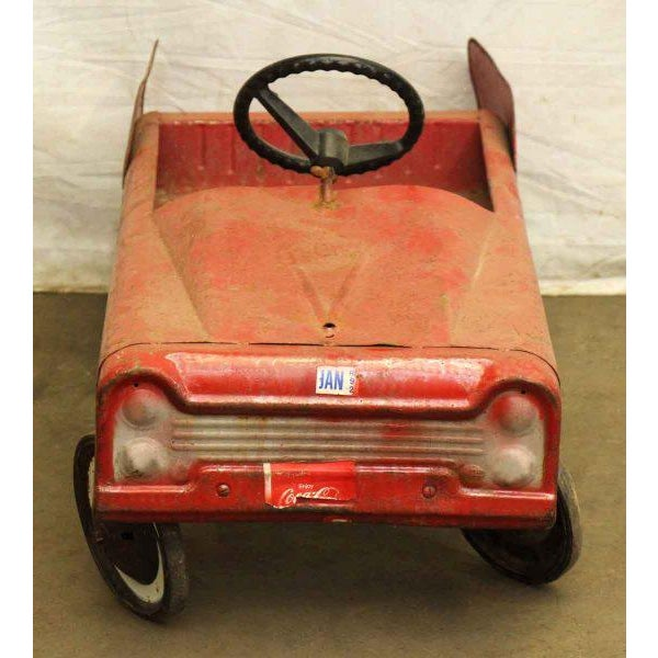 Vintage peddle car for children with a working steering wheel. The front and back seat are great for another passenger or...