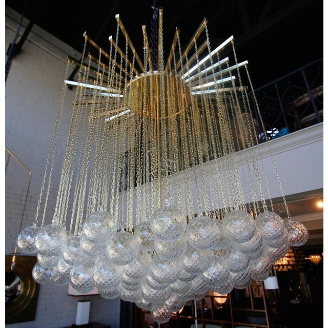 1970s Italian chandelier with 137 glass balls hanging from fine brass chains from a starburst frame. L-360