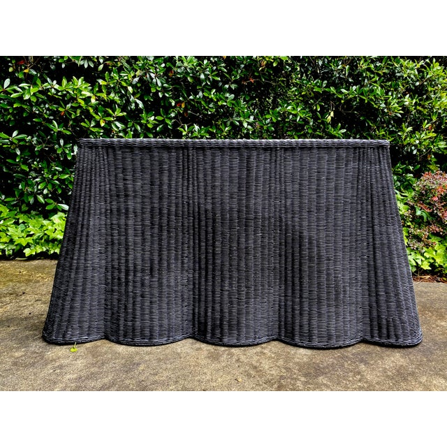 Hand woven natural rattan/wicker console table with sturdy metal frame inside. Beautifully hand woven draped design on all...