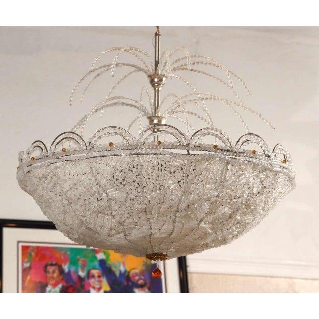 Art Deco Lalique style crystal basket chandelier. The fine crystal dome basket having a Lalique style design. The top...