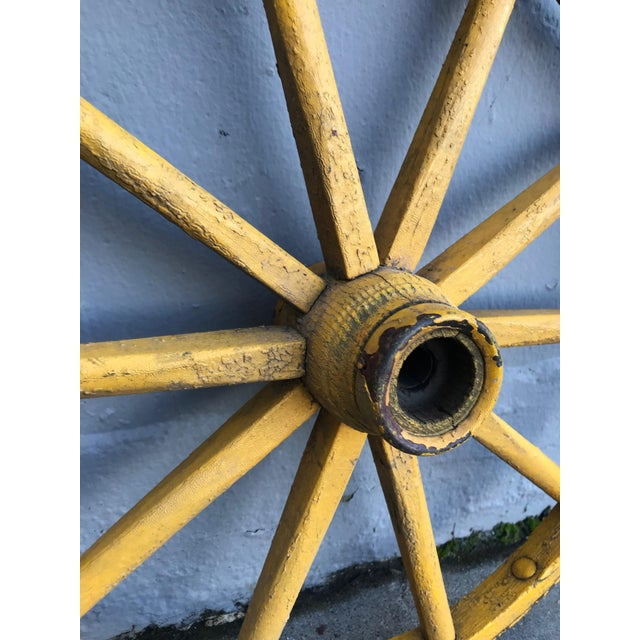 Original folk art pair of painted wagon wheels. They are most likely from a four wheel childrens wagon.
