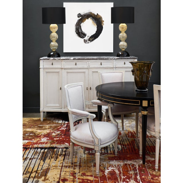 """Painted Louis XVI style buffet with marble top. This mahogany piece has been painted in the """"Trianon"""" gray blue color that..."""