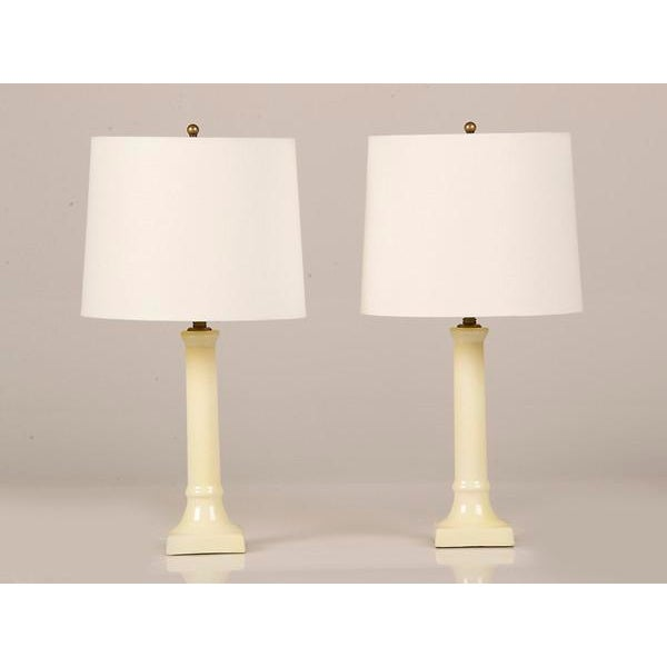 A pair of matching ceramic candlesticks from France c. 1920 now converted to custom lamps. Please notice the elegantly...