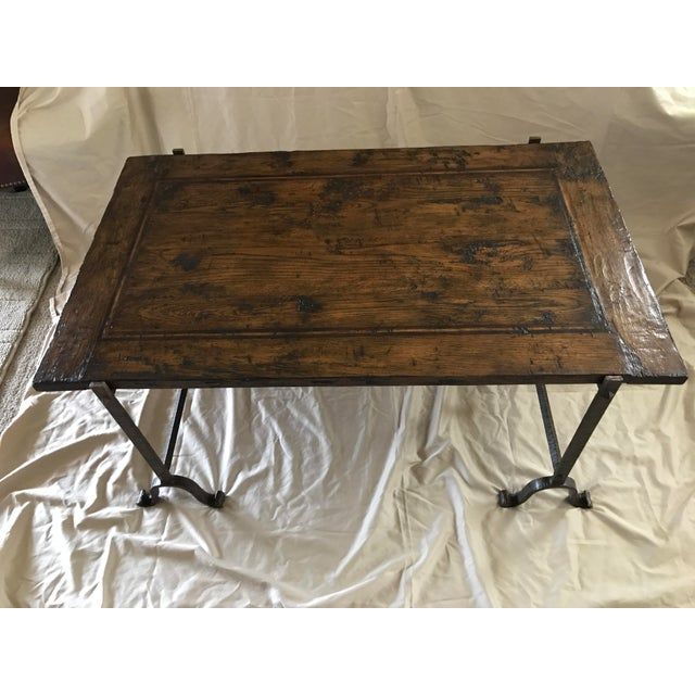 Unique coffee table! Like new, although made to look antique. Iron color is a browning, not gray. High quality. Solid.