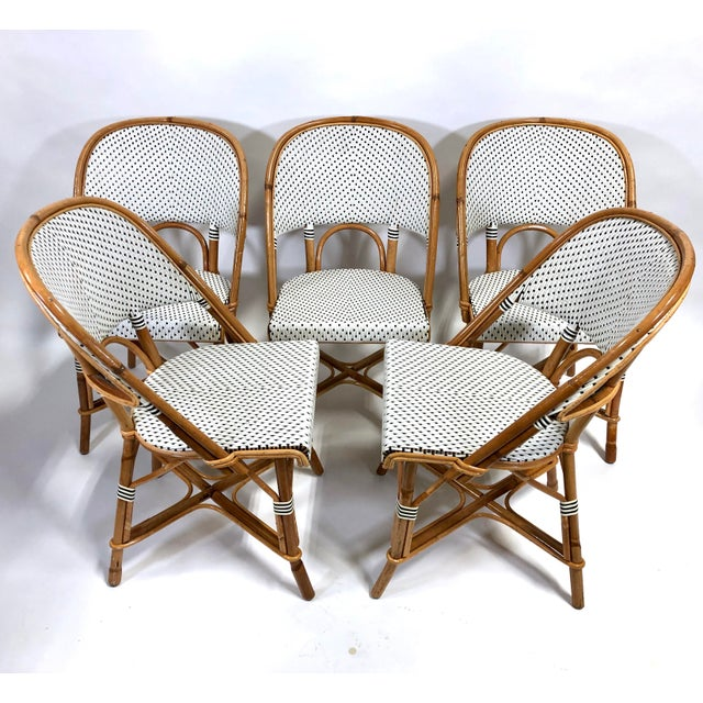 Fabulous set of Maison Drucker French bistro chairs in desirable neutral color palette of camel, black and white....