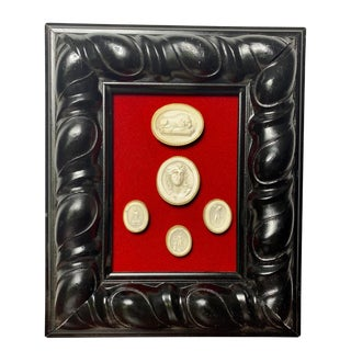 Early 19th Century Grand Tour Arrangements of Italian Cameos With Baroque Style Frame For Sale