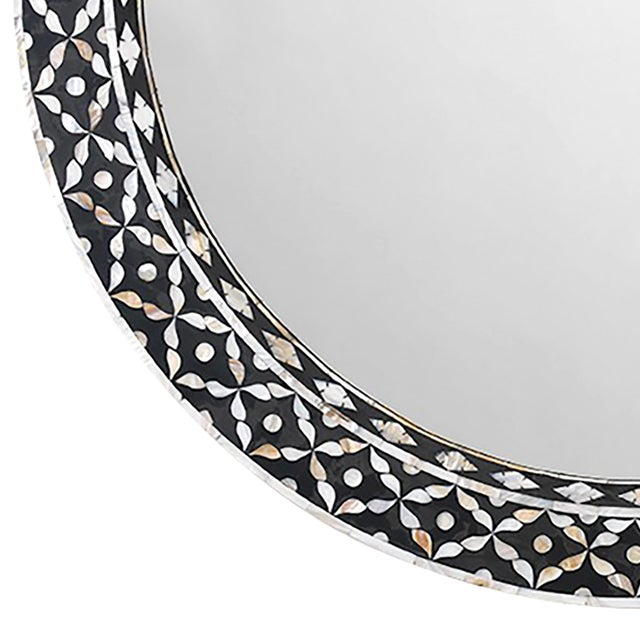 The Evelyn round mirror by Jamie Young exudes globally inspired style in contemporary rooms. Mother of pearl inlay creates...