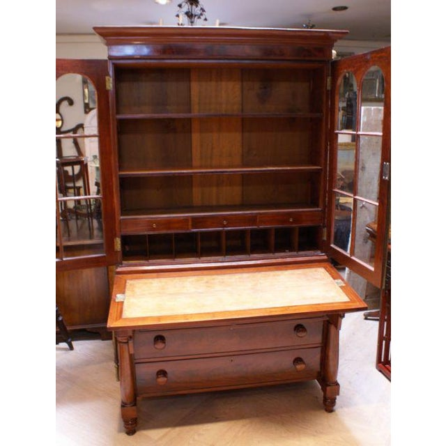 A nice small scaled American Empire period secretary chest made during the first half of the 19th century.