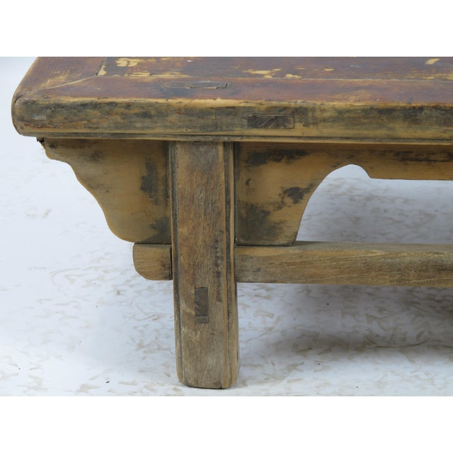 This rustic wood table was retrieved from the villages in Shandong province. Those type of low table was used to place on...