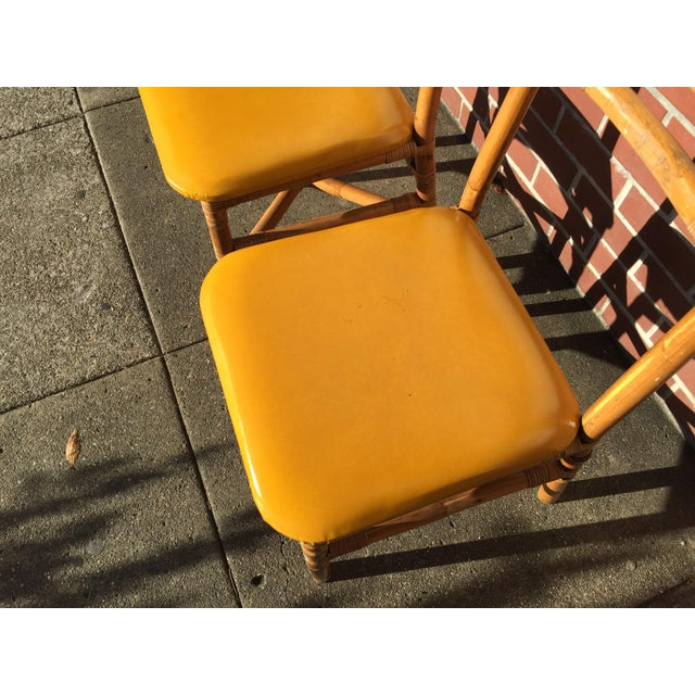 Pair of Bamboo Side Chairs made in Taipei Circa 1950. In excellent condition. A few light scuffs on yellow upholstery....