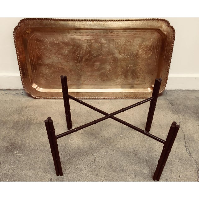 Hollywood Regency style, mid-century brass tray table with etched rectangular brass tray. Sit on a metal faux bamboo base...