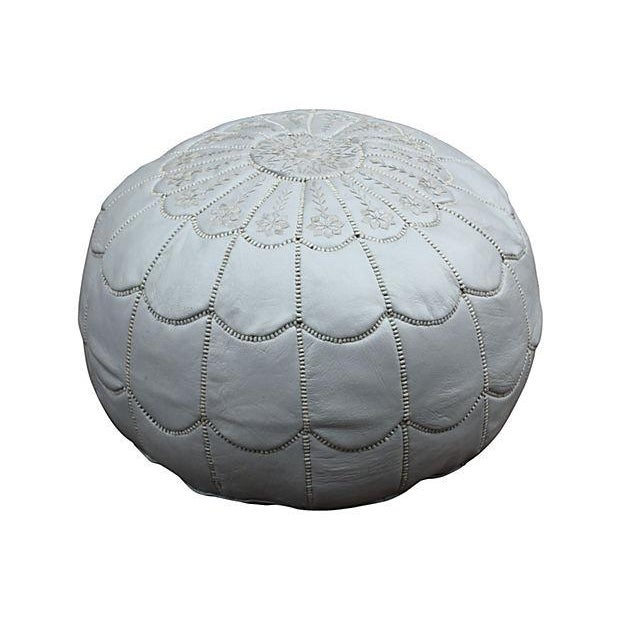 Handmade Moroccan leather pouf in silver color with an intricate embroidery and pattern. Zipper closure. Insert is...