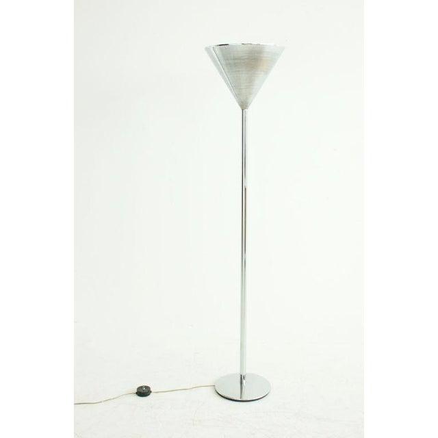 Chrome plated steel floor lamp with spun aluminum shade.