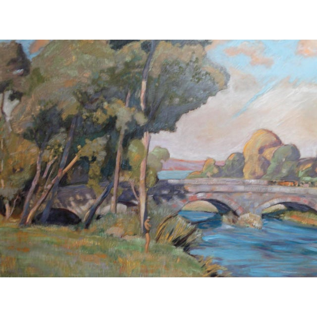 The stone bridge with its twin arches makes this lovely painting feel like a British landscape to us. We love the figure...