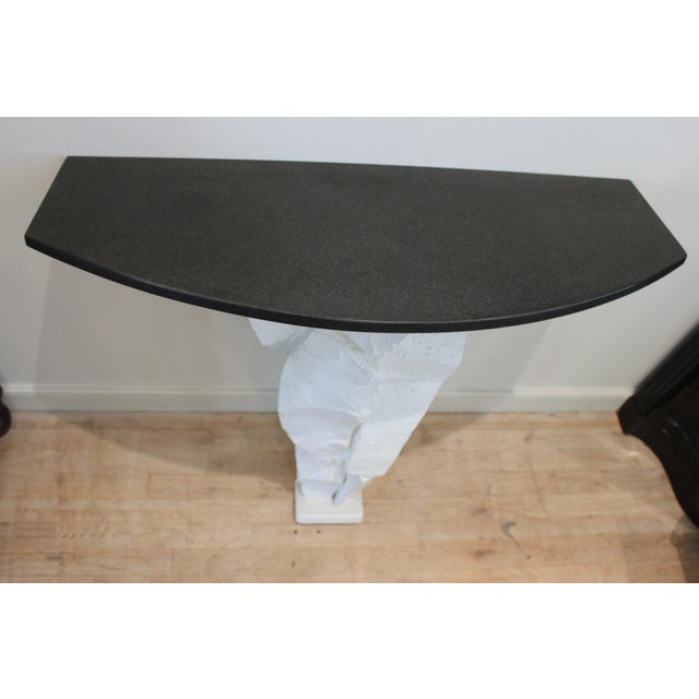 Brutalist white fiberglass console table with black honed stone top. Made in the mid 20th century.