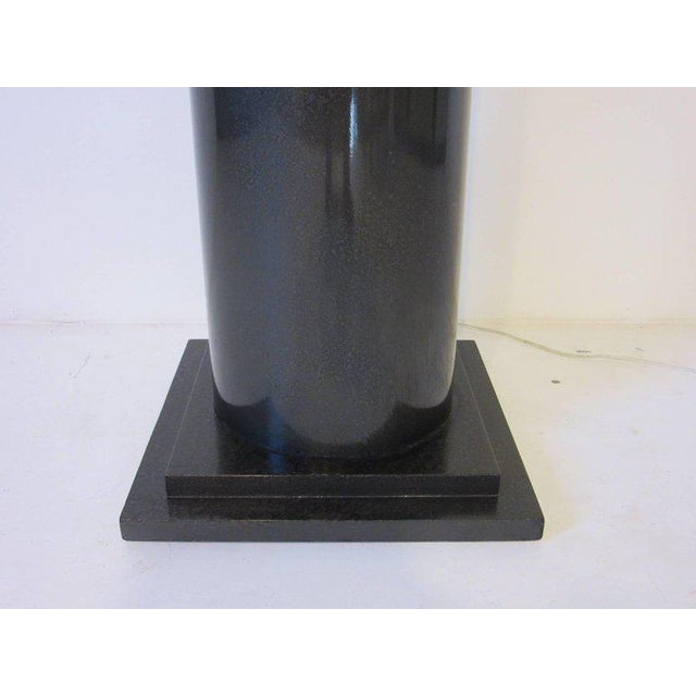 A Lucite Memphis styled column pedestal finished in a gun metal gray hammer coating with step up base and thick frosted...