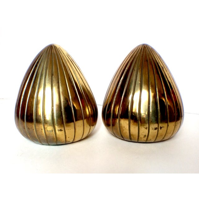 "Fantastic, and highly sought after brass ""Clam"" bookends by the amazing modernist engineer/designer Ben Seibel. If you..."