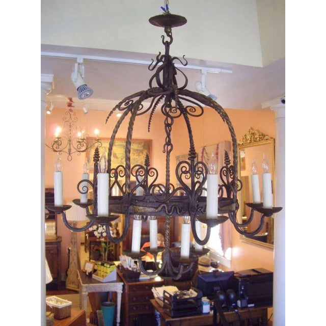 French Provincial Unusual Provincial Wrought Iron 12-Light Chandelier For Sale - Image 3 of 9