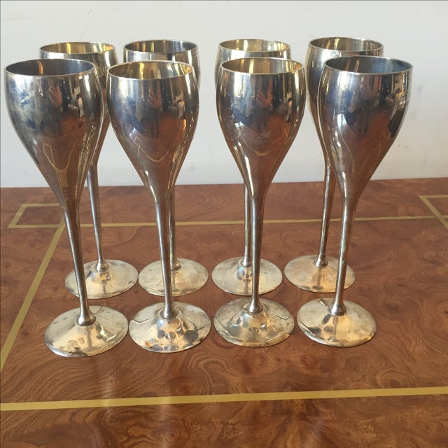 A set of 8 silver plated glasses/goblets/flutes perfect for entertaining. Made in India label on bottom. Has tarnishing,...