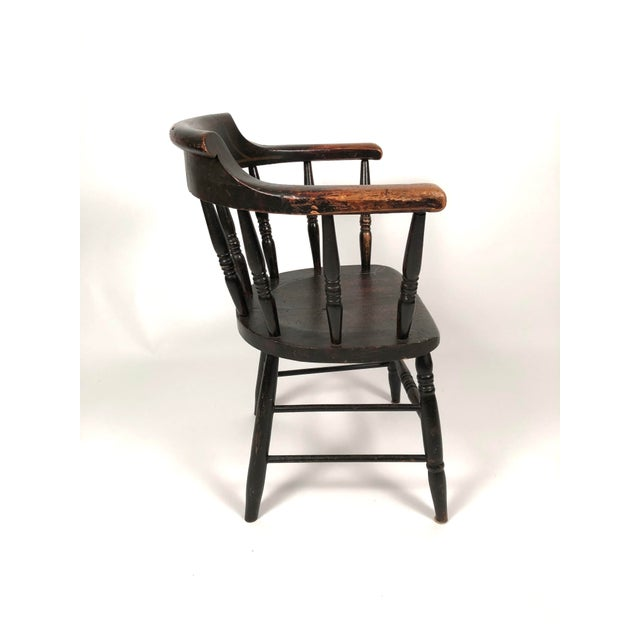 A hard to find matched set of 8 country captain's chairs in their old black paint with pinstripe decoration, each with a...